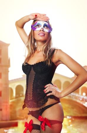 sexual beautiful girl in carnival dress at sunrise of Venice Stock Photo - 14177620