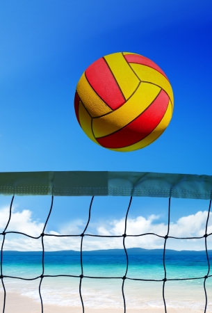 volleyball ball over grid on beach at sunny day