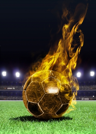 fiery soccer ball on playing field of stadium