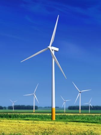 green meadow with Wind turbines generating electricity  Standard-Bild
