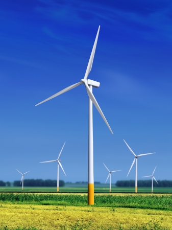 green meadow with Wind turbines generating electricity  Banco de Imagens