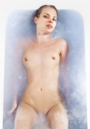 nude wet: beautiful woman in the hot bath with vapor of spa salon