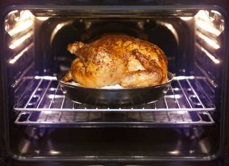 oven: appetizing roast turkey and potatoes in the oven Stock Photo