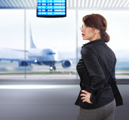 business woman waits the flight at the airport photo