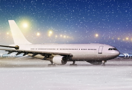 airport and white aircraft at non-flying weather, winter time Stock Photo