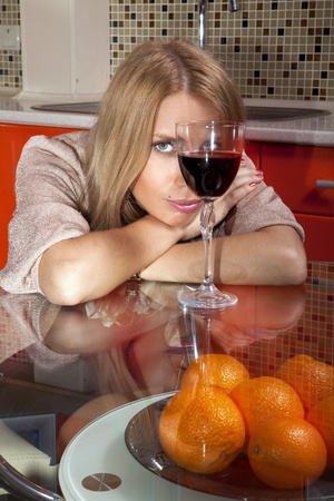 beautiful woman in shine dress with glass of wine Stock Photo - 17605442
