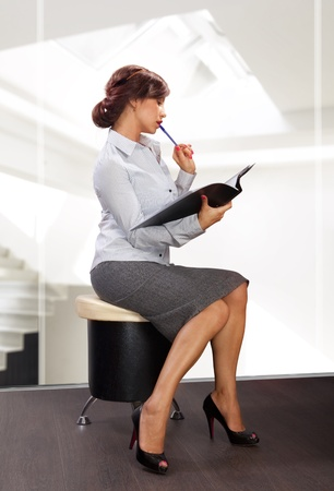 elegant business woman reads documents at modern office Stock Photo - 20532903