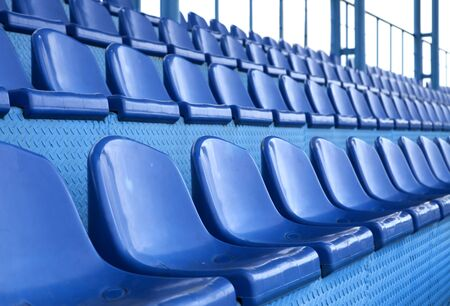 Empty plastic seats at stadium, open door sports arena.  photo