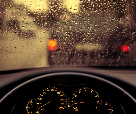 inclement: rain droplets on car windshield, blocked traffic  Stock Photo