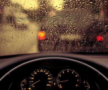 rain droplets on car windshield, blocked traffic  Standard-Bild