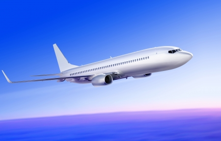 flying-up white passenger plane in the sky at sunrise