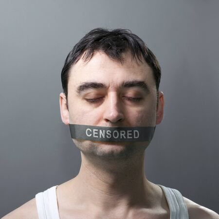 interdict: mans portrait with bandage on his face which represents censorship of statements