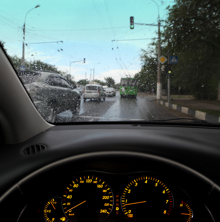 rain droplets on car windshield, traffic in city Stock Photo - 22363781