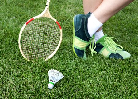 recreate: foot of badminton player who stays on grass