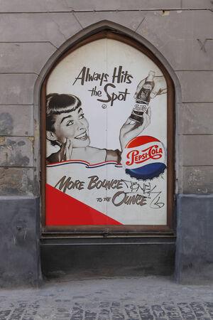 advertizing: ancient advertizing of Pepsi on city wall