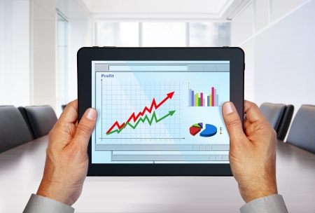 touch pad with computer graphics on screen in hands Stock Photo
