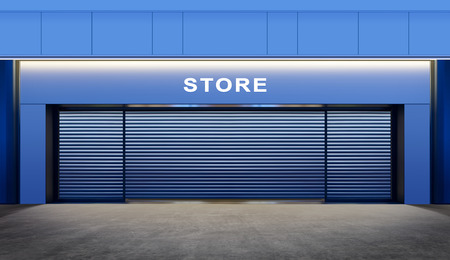 modern empty store with roller shutter doors on street at night time photo