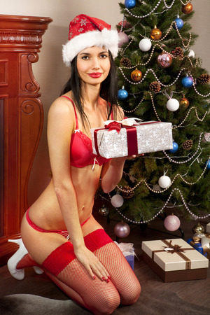 mrs claus: sexy young Santa-girl in red bikini with presents