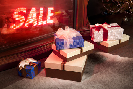 New Years sale of gifts in shop, boxes packed by tapes and bows