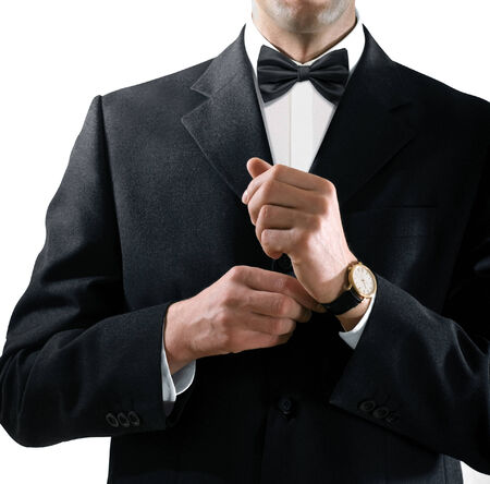 jazzbow: hands of the man who in a black tuxedo puts on his watch