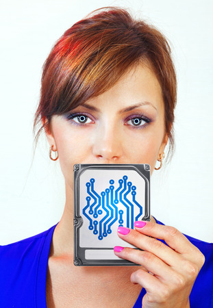 business mind: beautiful female android holds digital device on her hand