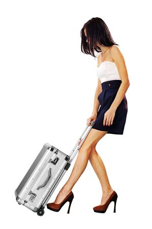 clumsy: girl going on vacation with suitcase over a white background Stock Photo