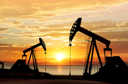 sun oil: silhouette of working oil pumps on sunset background Stock Photo