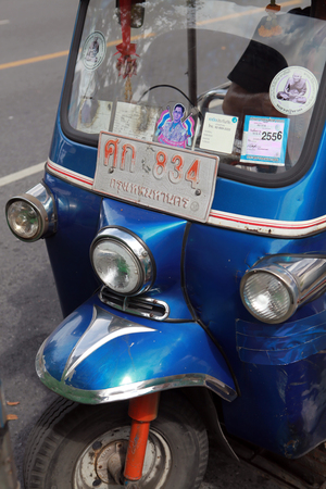mototaxi: BANGKOK ,THAILAND - DECEMBER 23 2015 : Tuk-tuk moto taxi on the street in the Pratunam area in Bangkok. Famous bangkok moto-taxi called tuk-tuk is a landmark of the city and popular transport.
