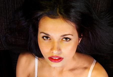 orgasm: close up face of voluptuous girl derives pleasure