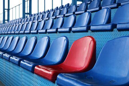 yellow tigers: Empty plastic seats at stadium, open door sports arena.