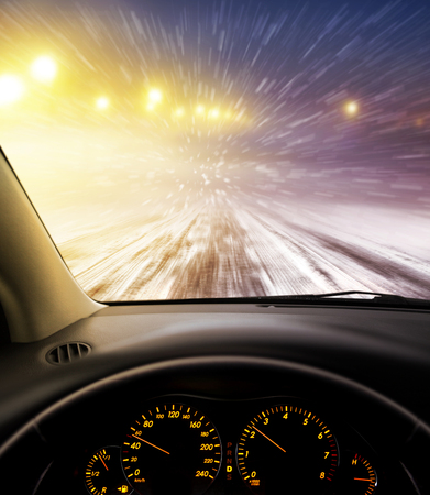 dangerous: view through car windshield to snow-covered road