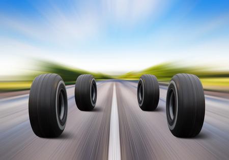 velocidad: cuatro ruedas de automóviles se apresuran en la carretera con alta velocidad