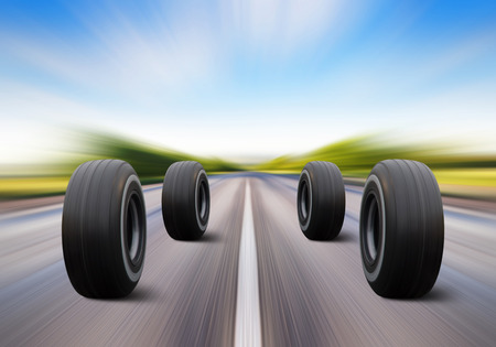 summer tire: four automobile wheels rush on the road with high speed
