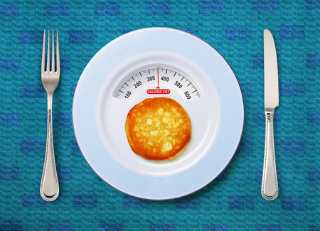 tot: view of calorie tot in pancake that on white plate Stock Photo