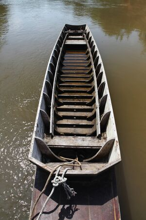 anchoring: old wooden row boat on river Stock Photo