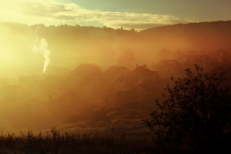 carpathian mountains: sunrise with fog over countryside at autumn