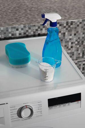 washable: part of washing machine and laundry powder for washing day Stock Photo