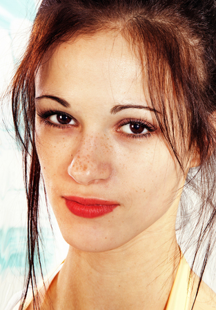 comely: closeup girls face with freckles, sight to camera