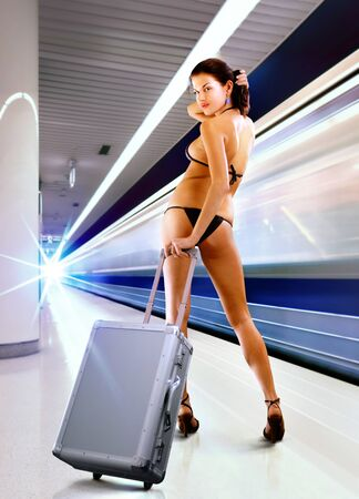 beautiful sexy woman in underwear with luggage in subway photo