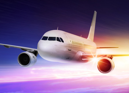 passenger plane is accelerated at sunset Stock Photo