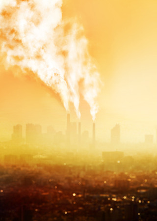 smokestacks: a view of atmospheric air pollution from factory Stock Photo