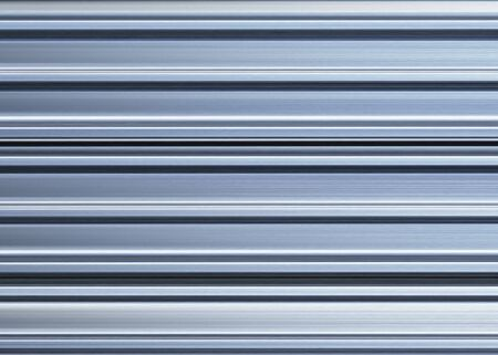 specular: shining metal roofing sheets for a roof covering in construction Stock Photo