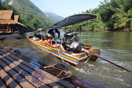 shallop: LANNA, THAILAND - DECEMBER 20: Taxi boats near pier for travelers and tourists who expect departure down to Khwae river in Thailand on December 20, 2013 in Lanna