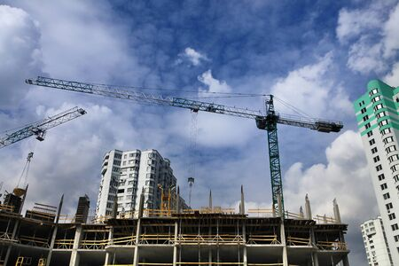 housebuilding: cranes and construction of new microdistrict in Kiev city Stock Photo