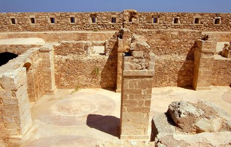 wall and column in Firka fortress at sun day, Crete.