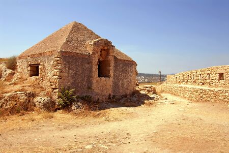 wall and house in Firka fortress at sun day, Crete. Stock Photo