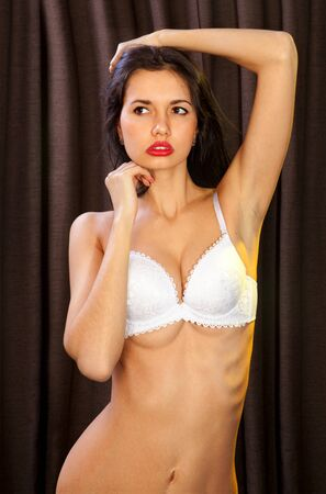 lascivious girl in white bra looks very sexy Stock Photo