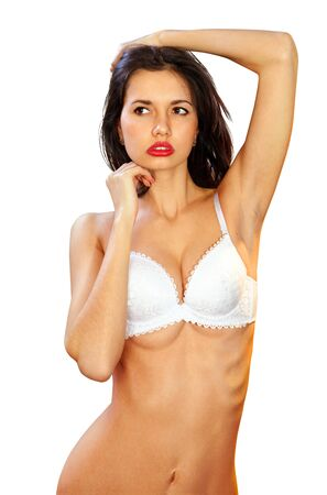 lascivious girl in bra looks very sexy, isolated on white background Stock Photo