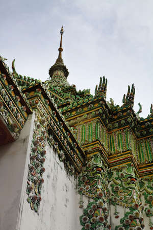 part of Beautiful Wat Phra Kaeo temple with green mosaic gable in Thailand