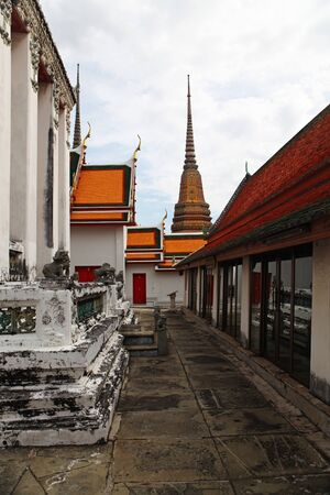 part of Beautiful Wat Phra Kaeo temple with orange and red roof in Thailand Stock Photo